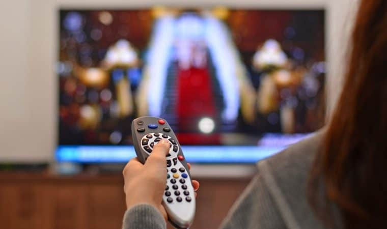 women-watching-tv-and-use-remote-controller-picture-id835487318-760x450
